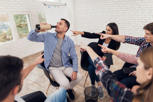Group of people point finger at adult man. Premium Photo