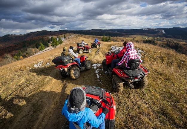 Group of people riding off-road vehicles Premium Photo