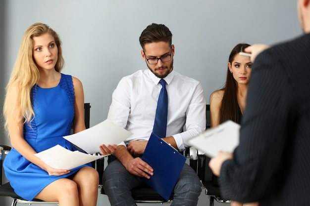 Group of people sit on casting chairs row at boss reception Premium Photo