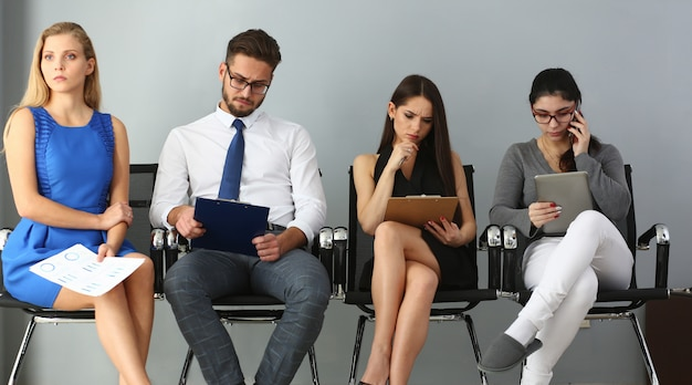 Group of people sitting on chairs during job casting Premium Photo