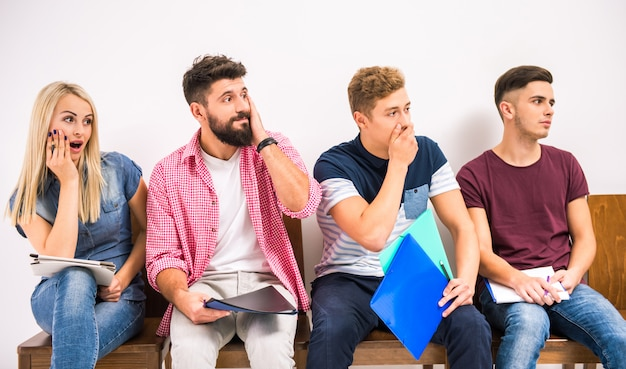 Group of people sitting on chairs waiting interviews Premium Photo