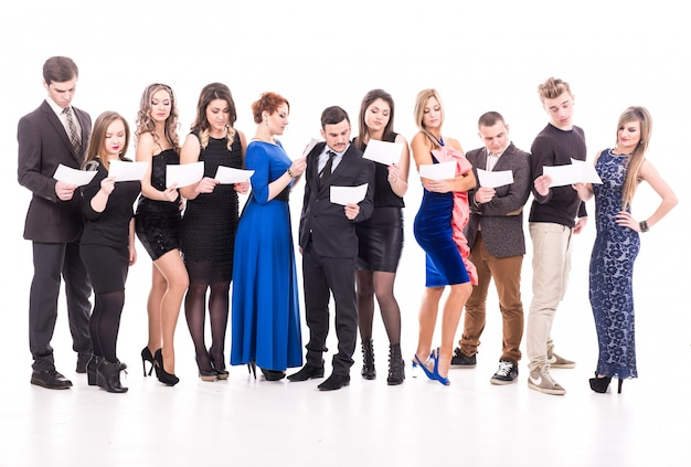 A group of people standing with white sheets. Premium Photo