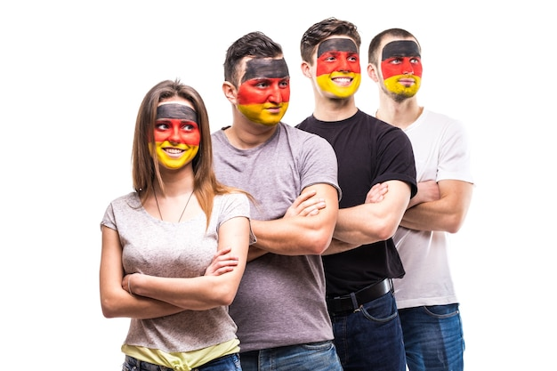 Group of people supporters fans of germany national teams with painted flag face. fans emotions. Free Photo