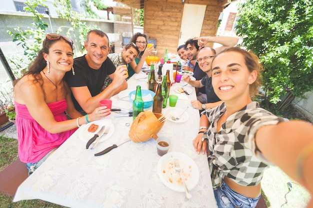 Group of people taking selfie while having lunch outdoor Premium Photo