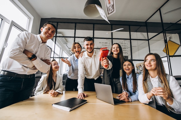 Group of people throwing money in an office Free Photo