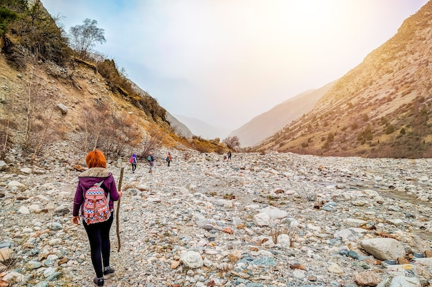 Group people tourists climbing rock mountain ridge travel tourism destination hiking. Premium Photo