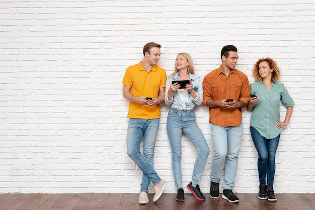 Group of people with electronic devices Free Photo