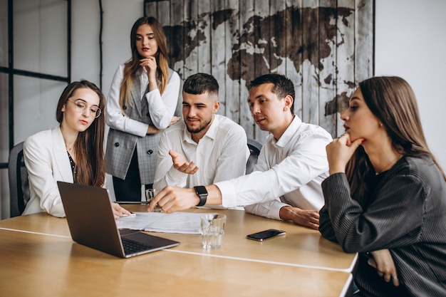 Group of people working out business plan in an office Free Photo