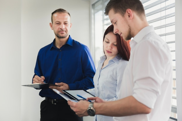 Group of people working with documents Free Photo