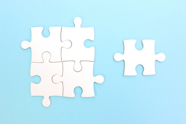 Group of puzzle and a puzzle piece. teamwork concept. think difference concept. leadership concept. Premium Photo
