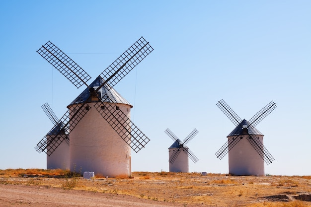 Group of retro windmills in field Free Photo