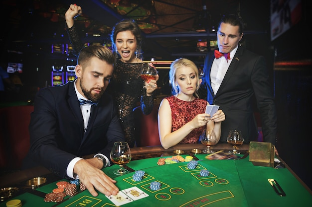 Premium Photo | Group of rich people is playing poker in the casino