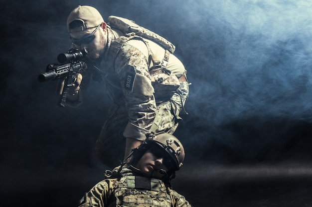 Group of security forces in combat uniforms with rifles Premium Photo