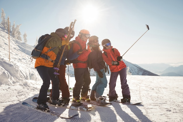 Group of skiers taking selfie on mobile phone Free Photo