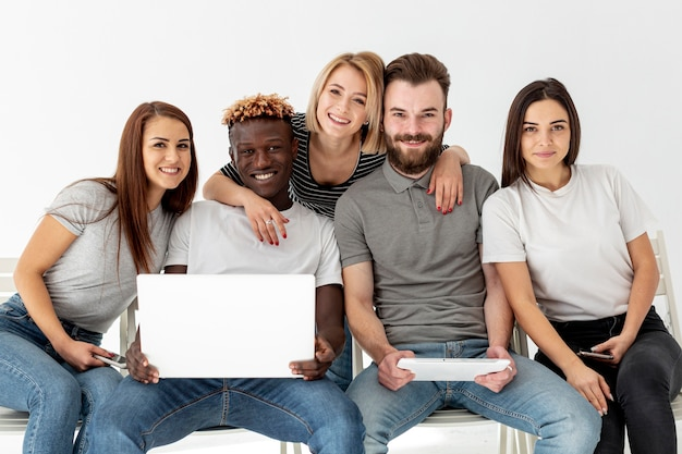 Group of smiley friends together Free Photo