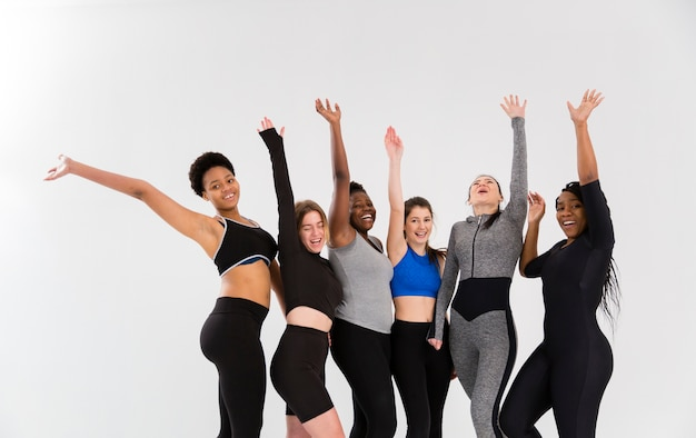 Group of smiley women at gym Free Photo