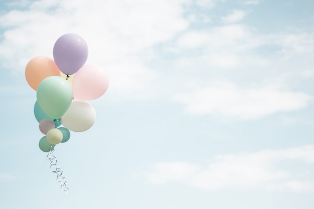 Group of soft pastel balloon with colorful on light blue sky. Premium Photo