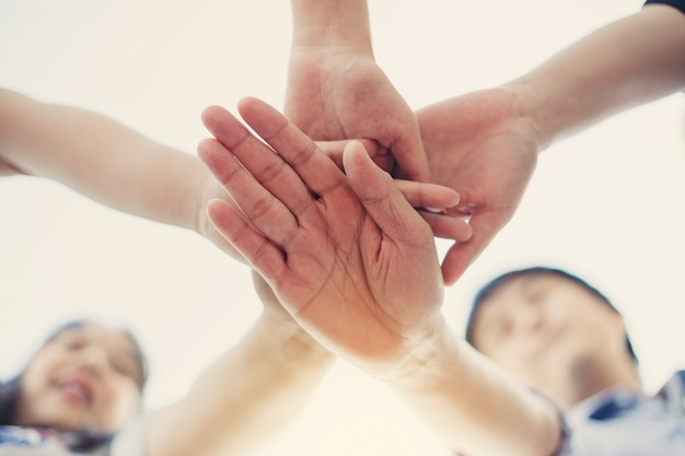 Group of students or businessman hands together joining for teamwork and business collaboration concept. Premium Photo