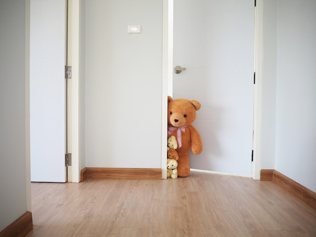 A group of teddy bears standing inside the house. Premium Photo