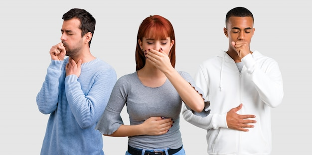 Group of three friends is suffering with cough and feeling bad Premium Photo