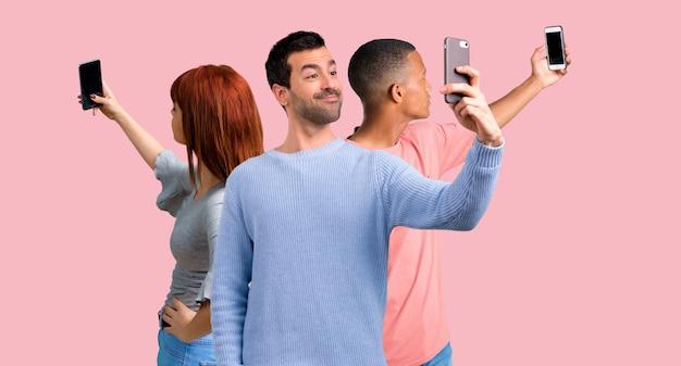 Group of three friends using mobile phone Premium Photo