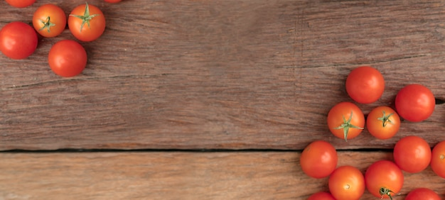 Group tomato place on the wooden table use for background Premium Photo
