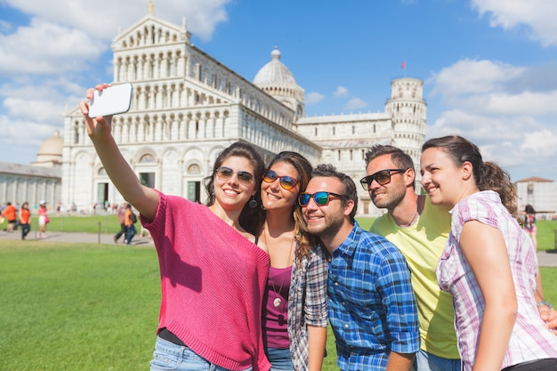 Group of tourists taking a selfie in pisa. Premium Photo
