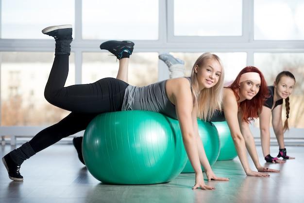 Group of women doing exercises on balls Free Photo