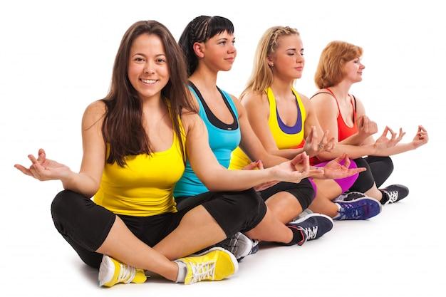 Group of women enjoying yoga Free Photo