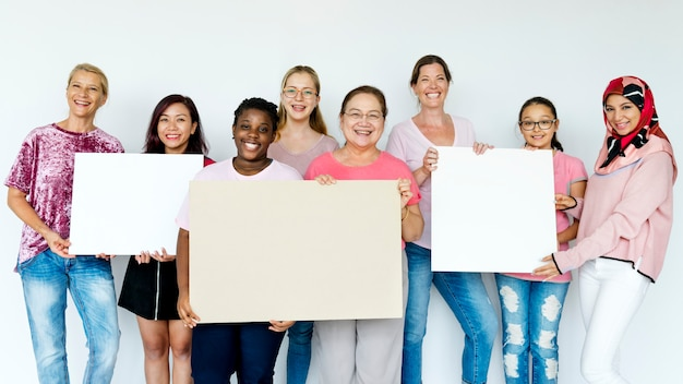Group of women holding boards Premium Photo
