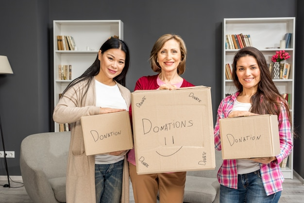 Group of womens with donation boxes Free Photo