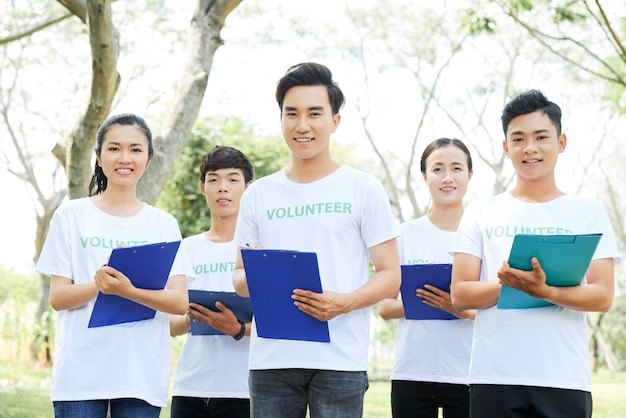 Premium Photo | Group of young asian volunteers standing outdoors