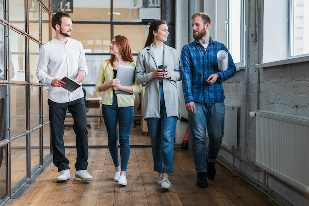 Group of young business colleagues walking together Free Photo