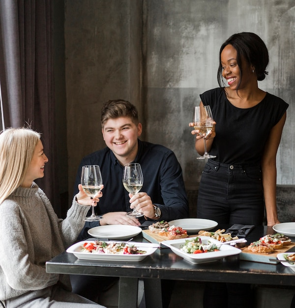 Group of young friends having wine together Free Photo