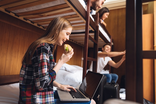 Group of young friends in plaid shirts moving in hostel. Premium Photo
