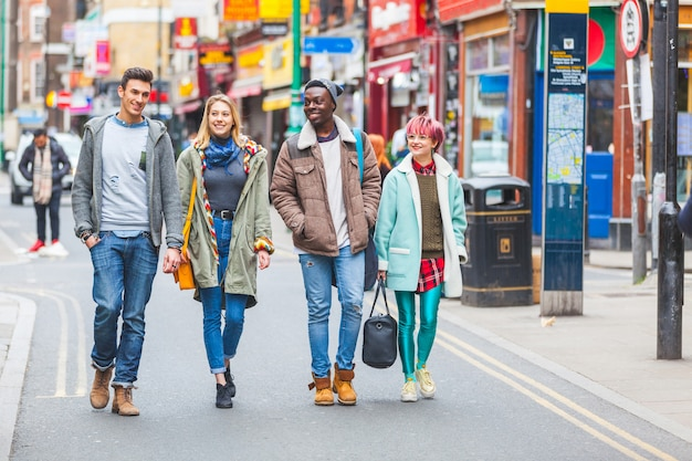 Group of young friends walking in london Premium Photo