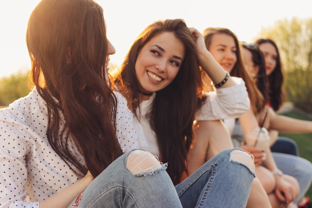 Group of young happy girls friends enjoy life on summer city street Premium Photo