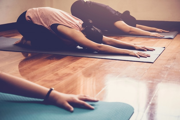 Group of young healthy asian women practicing yoga  lesson Premium Photo