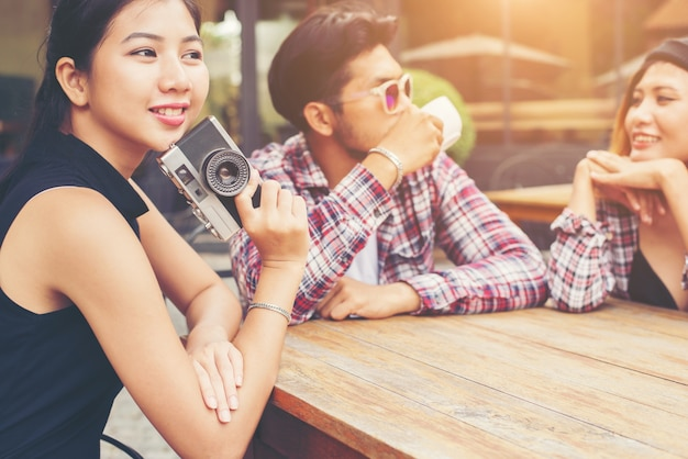 Group of young hipster sitting in a cafe,young cheerful friends Free Photo