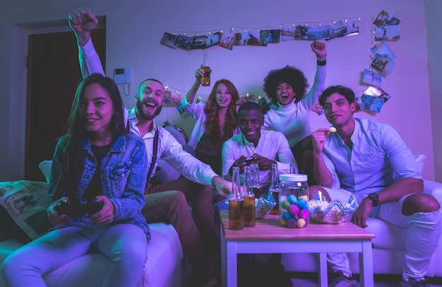 A group of young people celebrating and making party at home Premium Photo