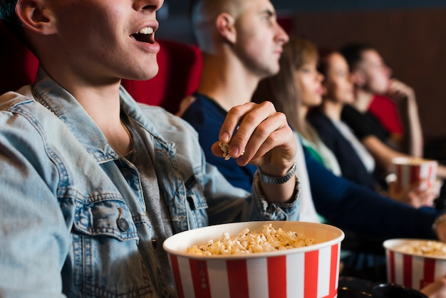 Group of young people in cinema Free Photo