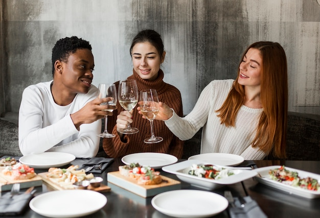 Group of young people having wine together Free Photo