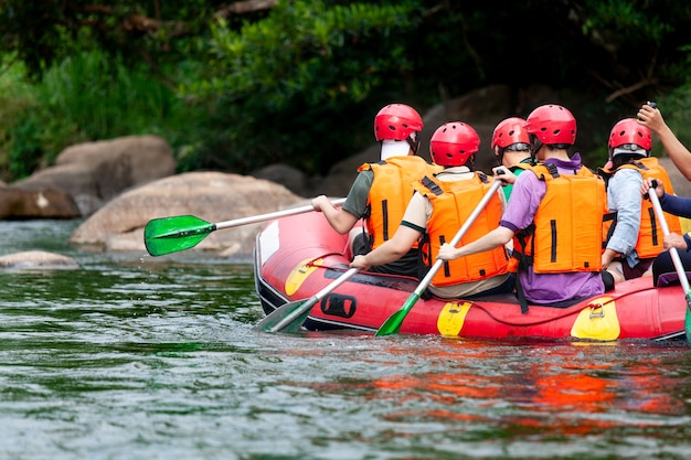Group of young person rafting on the river Premium Photo