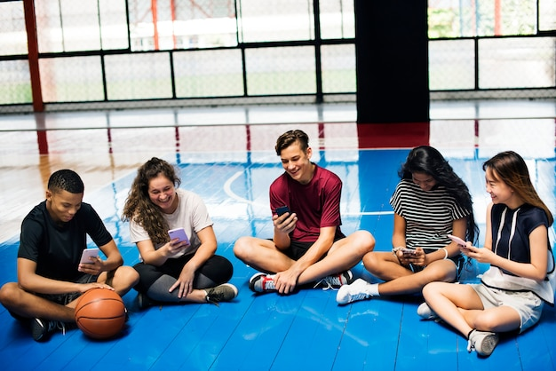 Group of young teenager friends on a basketball court Premium Photo