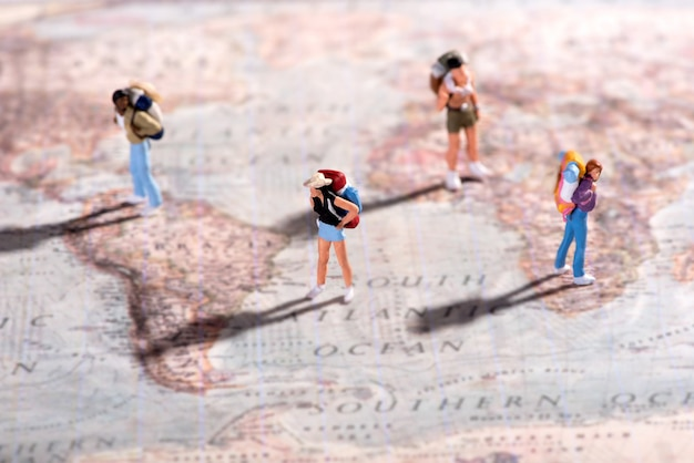 Group of young travellers on a world map Premium Photo