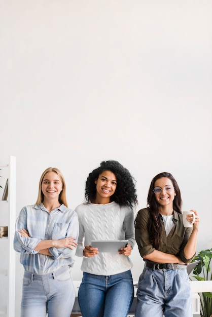 Group of young women posing together Free Photo