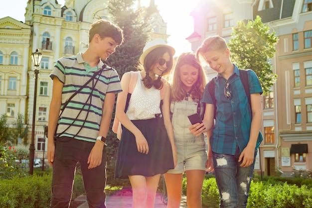 Group of youth is having fun, happy teenagers friends walking Premium Photo