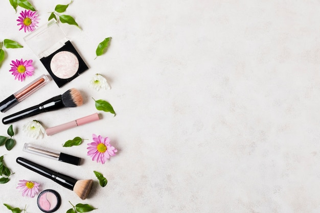 Grouped makeup products and brushes Free Photo