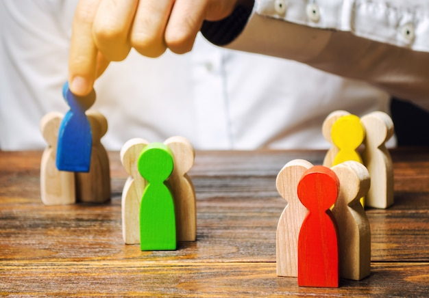 Groups of multicolored wooden people and businessman. Premium Photo
