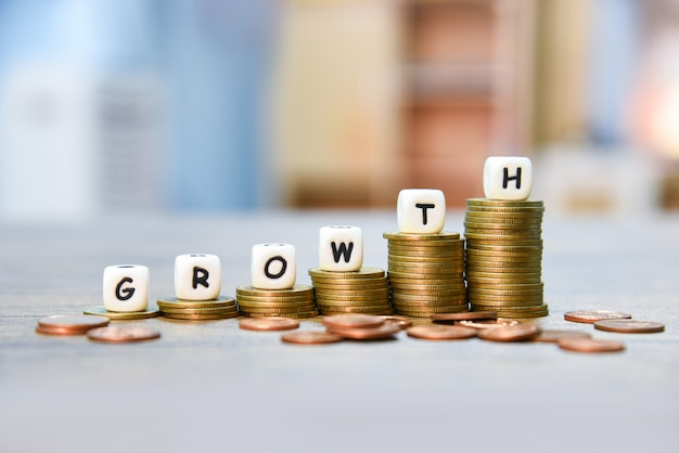 Growth concept stack of golden coins growth of infographics money graph up stairs business finance Premium Photo